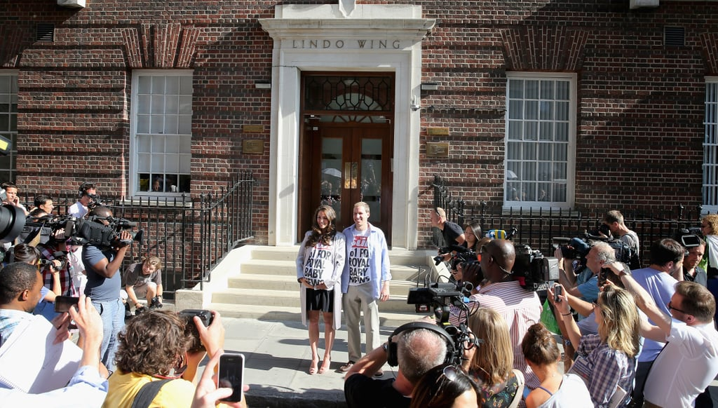 Prince William and Kate Middleton look-alikes stood outside the hospital to pose for pictures.