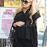 Jessica Simpson kept her hand on her baby bump for a day of shopping in LA.