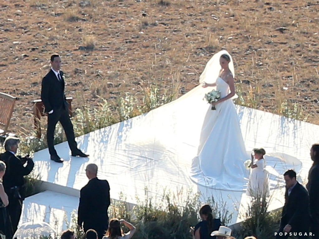 "Kate Bosworth and Michael Polish tied the knot in Montana on Saturday, and we're sharing pictures from the pair's wedding day. The couple enjoyed an intimate ceremony with their closest friends and family in Philipsburg, MT, saying, ""I do,"" on a bluff at The Ranch at Rock Creek. Lake Bell was among the guests who stayed on the property for the weekend, and she gave a sweet kiss to her husband after they witnessed the nuptials.  Kate wore a custom Oscar de la Renta dress for their big day — a strapless ball gown with an eight-foot train — and she carried a bouquet of white flowers. The flower girl's outfit coordinated with Kate's, Michael sported a Brooks Brothers suit, and the couple exchanged custom wedding rings from Ocappi. Adding to the couple's rustic, romantic theme was a horse and carriage that was on hand after the ceremony. Take a look at their sweet ceremony!"