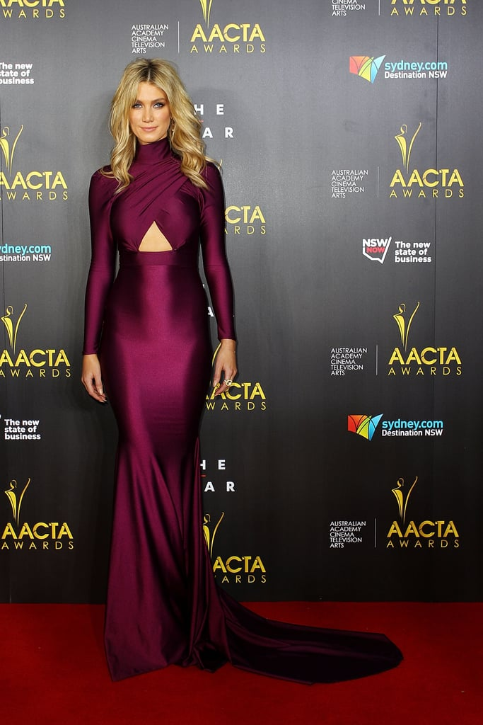 Michael Costello's sleek cut-out was a chic option for Delta Goodrem. Even with a high neckline, sleeves and floor-sweeping length, she still managed to flash a cheeky bit of flesh.