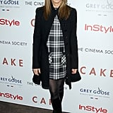 For a Cake screening in November 2014, she paired tights with a plaid dress and knee-high suede boots.