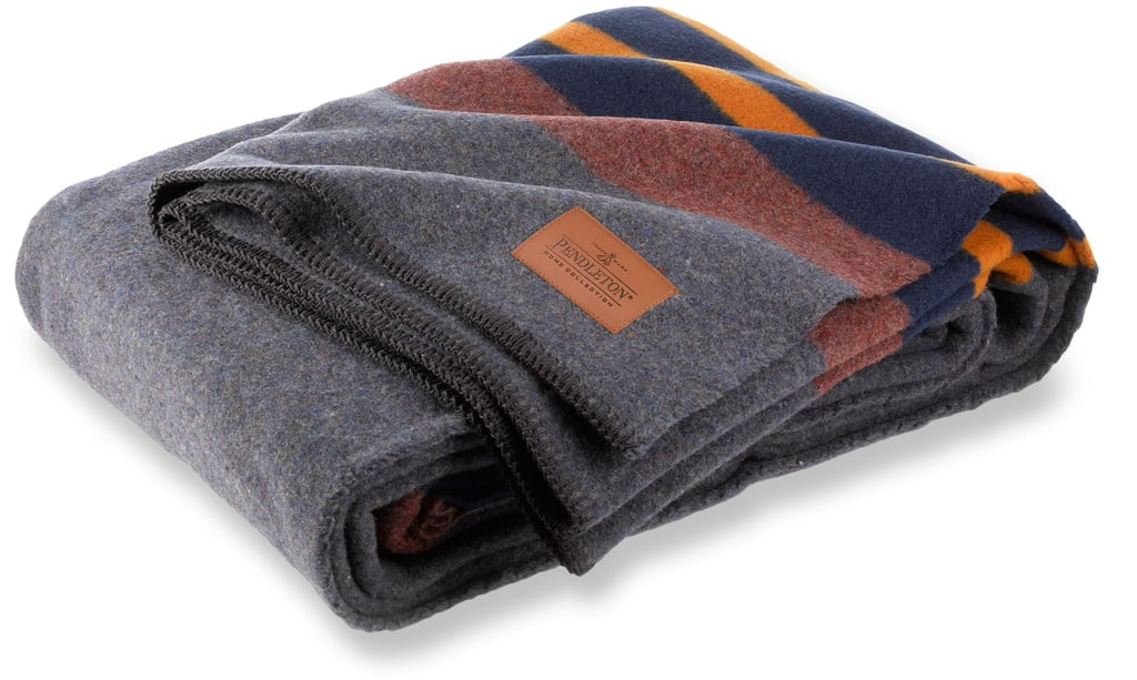If he loves the great outdoors, he'll definitely appreciate the classic Pendleton vintage camp blanket ($88).