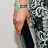Malin Akerman added this standout Chopard bracelet to her draw out the green hue of her printed gown.