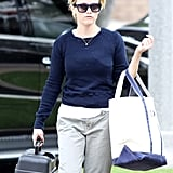 Reese Witherspoon sported navy blue sunglasses and a sweater.