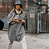 How to Wear a Shirt Jacket: With a Turtleneck + Pants + a Clutch + a Bucket Hat