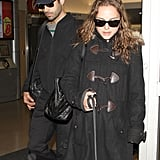 Natalie Portman and Benjamin Millepied arrived at an NYC airport in 2011.