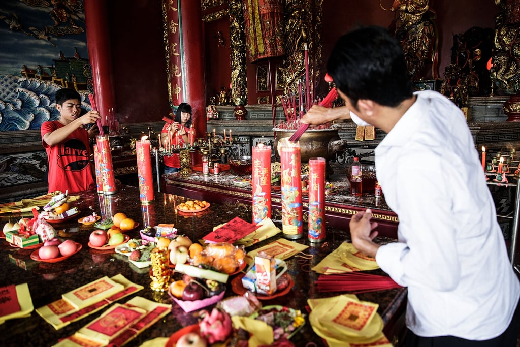 A man burned incense at the Satya Dharma Temple in Bali.