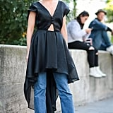 Layer your fanciest cocktail dress over cropped jeans and heels.
