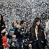 Camila posing with (from right to left) Andie McDowell, Eva Longoria and her son Santiago, Cheryl Cole, and Helen Mirren, under a shower of silver confetti during the finale of the Le Defile L'Oreal Paris fashion show.