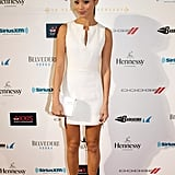 Jamie Chung attended the 10th annual Leather & Laces party in a structural white shift, only adding sleek gold sandals and a white clutch as the finishing accents.