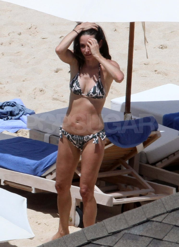 Courteney Cox Takes a Friendly Bikini Dip With Josh Hopkins and Coco