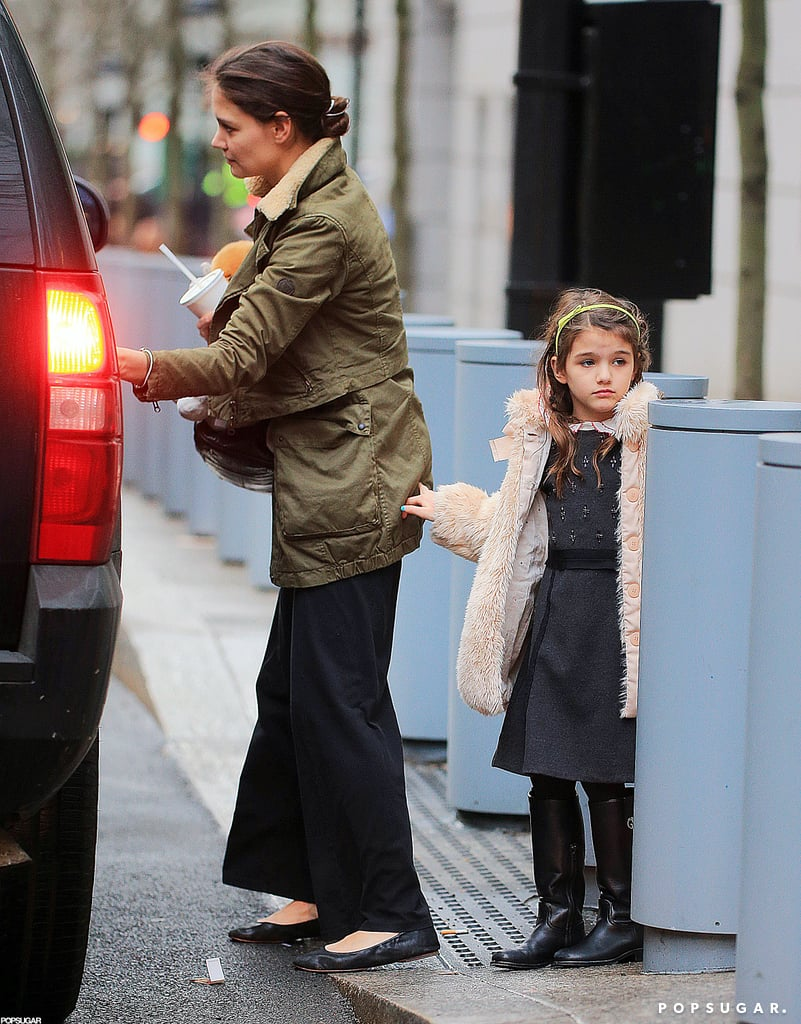 Katie Holmes and Suri Cruise stopped by a Shake Shack in NYC yesterday after Suri finished her day at school. Suri bundled up in a faux-fur coat for the outing, while Katie kept things casual in a military jacket and ballet flats.  Katie's latest run on Broadway ended earlier this month. Dead Accounts closed sooner than projected after slow ticket sales. Katie's forging ahead, however, with several other fashion and beauty projects during her break from the stage and screen. Her line, Holmes & Yang, won't show at New York Fashion Week next month, but on the beauty front, she's featured in new ads for Alterna. Katie won't only be modeling for Alterna, but will also serve as a consultant on the hair care line's product range.