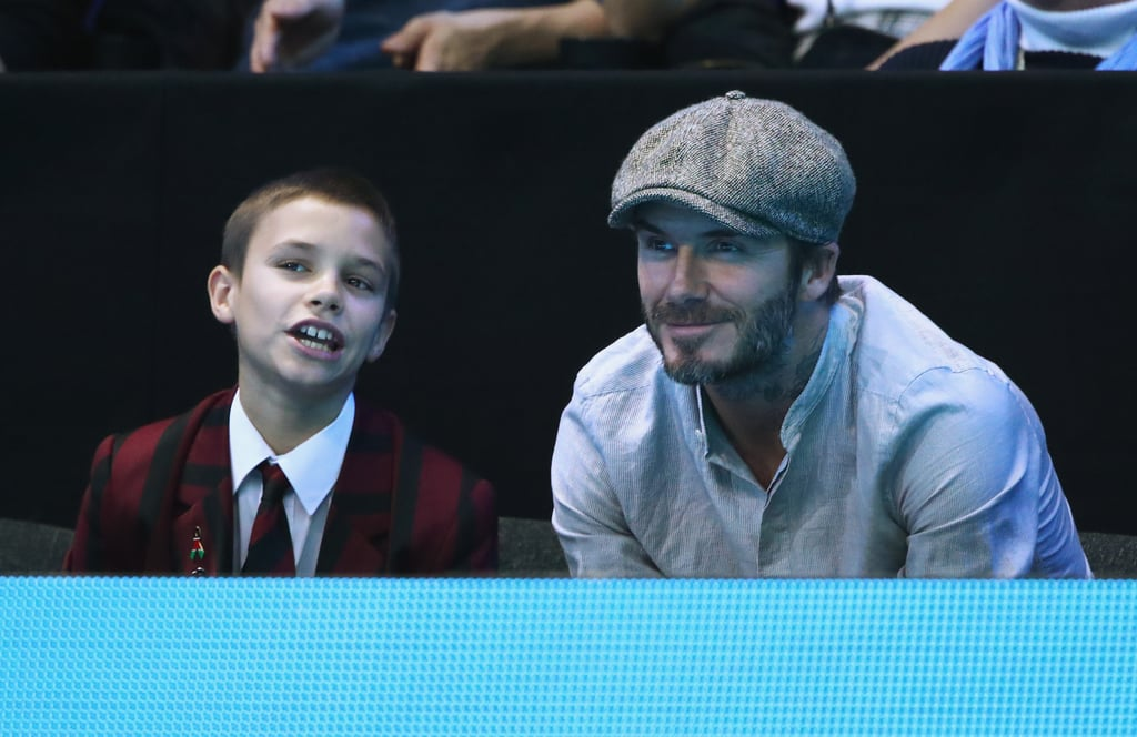 """David and Romeo Beckham squeezed in some sweet father-son bonding when they attended the ATP World Tour Finals in London on Thursday. The duo attentively watched the men's doubles match between Jamie Murray and Bruno Soares, and Romeo was so into the game, he even snapped some footage on his phone — perhaps he wanted to show his brothers what they missed? David has been spending a lot of time with his family as of late. After attending the Alibaba Global Shopping Festival with wife Victoria earlier this month, the former football player returned home to London, where he reunited with his 5-year-old daughter, Harper. On Tuesday, David posted a photo of Harper riding a scooter around town, writing, """"Loving London 🇬🇧❤️."""""""