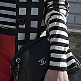 Graphic prints were paired with a timeless quilted Chanel chain bag.