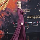 Jen's glamorous Dior gown at The Hunger Games: Mockingjay Part 2 world premiere was a memorable shade of plum, and the side cutouts at the sleeves made quite the impression. She completed her custom design with Neil Lane jewels.