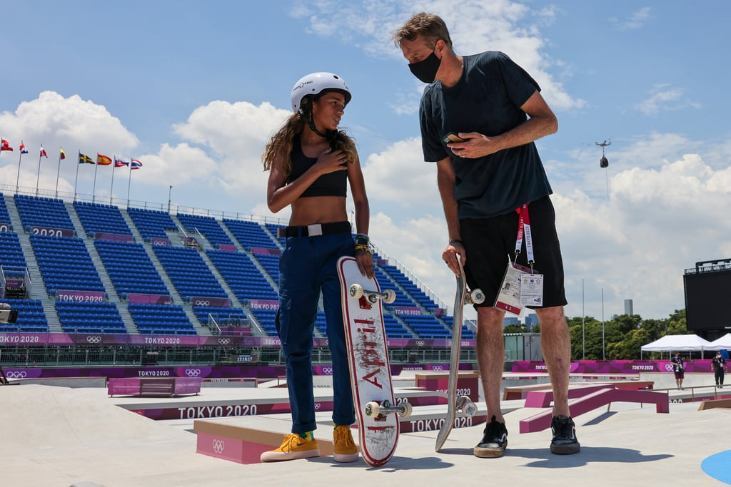 """Tony Hawk is proudly passing the baton on to the next generation of skateboarders. On July 24, Rayssa Leal shared details about her exciting meet-up with the X Games pro on the Tokyo training ground. For the 13-year-old Olympian from Brazil, this special moment signifies years of growth as an athlete. """"Six years ago [Tony Hawk] introduced me to the world of skateboarding by sharing my video wearing a fairy costume,"""" Leal captioned a gallery of photos of herself and Hawk. """"Today, he filmed me at the Olympics."""" Back in 2015, Leal caught Hawk's attention with a video of her 7-year-old self heel flipping off stairs while wearing a """"fairytale"""" dress. Flash forward to 2021, and Leal is making her Olympic debut. """"This is all so amazing, I'm living a dream!"""" Leal said, and Hawk is cheering her on from the sidelines. """"You have exceeded all expectations!"""" he commented on Leal's photos. """"It's been an honour to be involved in some small way."""" See more of Leal and Hawk's meaningful chat in the photos and video ahead.       Related:                                                                                                           Skateboarding Gets Its First Olympic Gold, and It Goes to Hometown Hero Yuto Horigome"""