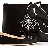 Feet looking bare? That's because you are without this Charlotte Olympia Embroidered Slipper Set (£686).