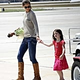Katie Holmes wore cowboy boots at the airport with Suri.