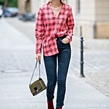 Style a fashion-tuck of a borrowed-from-the-boys oversize button-down, even if it is in hot pink and red!