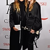 "Twinning combo: The duo donned what they called ""f*ck it flats"" while accepting their award for womenswear designers of the year at the 2015 CFDA Awards.   Ashley paired her Chanel flats with silky separates.  Mary-Kate kept her style cozy in Chanel loafers, black turtleneck, and long coat."
