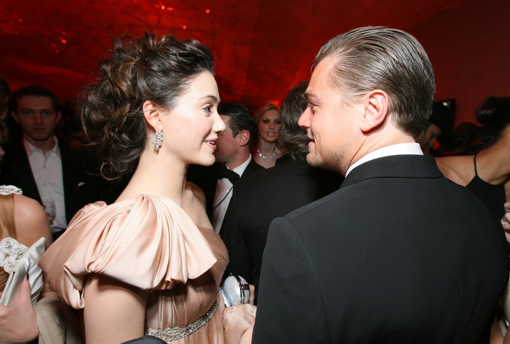 Leo shared a seemingly flirtatious moment with Emmy Rossum at the Vanity Fair Oscars afterparty in 2007.