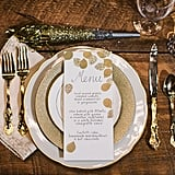 Silver and gold table settings add excitement to the meal.
