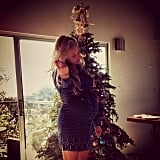 Teresa Palmer's husband, Mark Webber, took a candid photo of the expectant actress in front of their decorated Christmas tree. The couple will celebrate their next Christmas with their new bundle of joy.  Source: Instagram user likemark