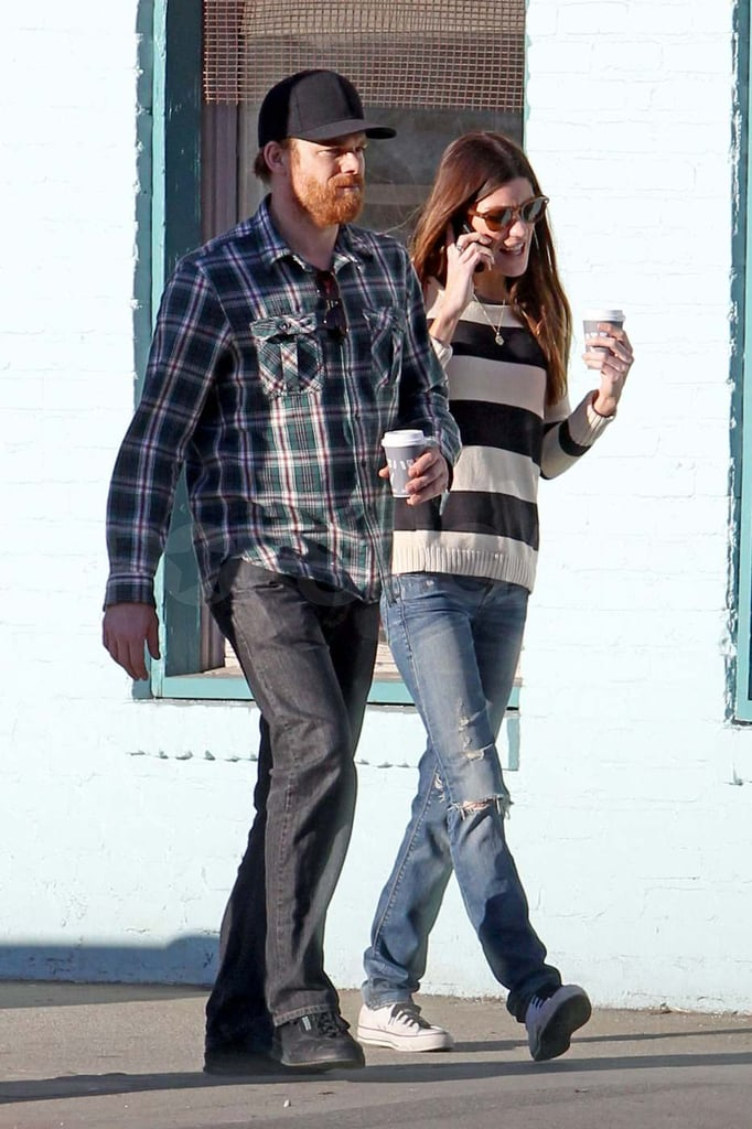 Jennifer Carpenter in a striped shirt with Michael C. Hall.