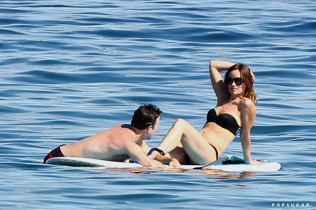 Olivia Wilde lounged on a surfboard during a trip to Hawaii with Jason Sudeikis in May.