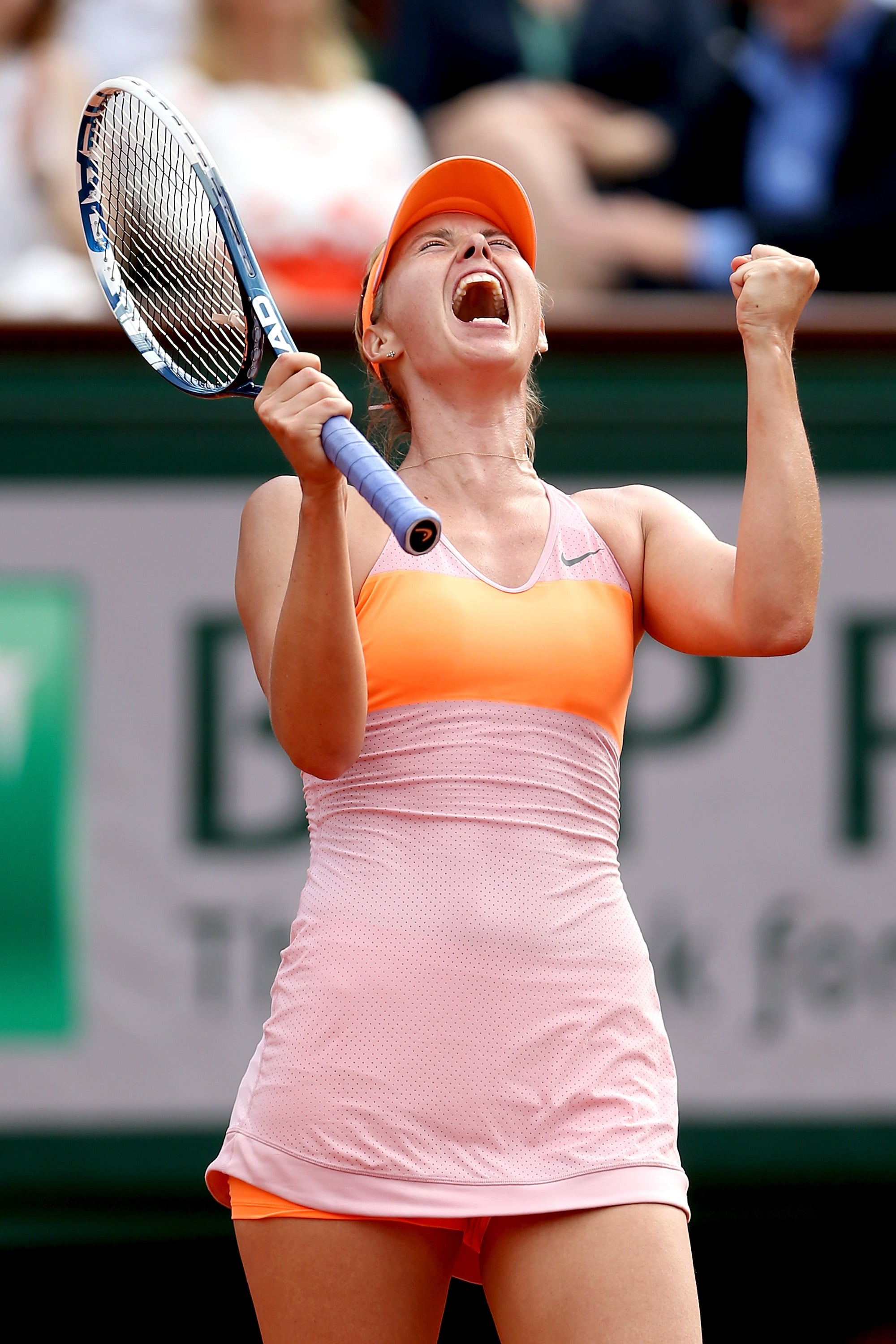 Maria Sharapova had something to celebrate: her colorful orange and pink ensemble was a smashing success at the 2014 French Open.