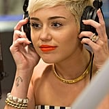 Miley Cyrus discussed her twerking video and a Snopp Lion collaboration on Ryan Seacrest's radio show.