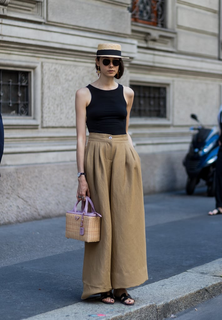 Team with a straw hat, styling high-waisted trousers and a simple top.