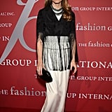 Long fringe and a chunky necklace added a funky edge to Olivia's dressed-up look.