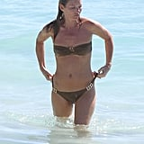 Kate Moss adjusted her bikini in St. Barts.