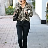 Lauren made an LA outing look completely chic in 2012 — she styled a cheetah-print from C. Wonder with black skinny jeans and flats. Lesson from Lauren: a pop of leopard is paramount.