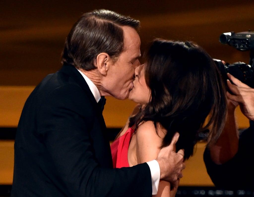 Julia Louis-Dreyfus got a big kiss from Bryan Cranston.
