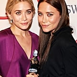 By the 2012 CFDA Awards, Mary-Kate was back to darkened hair. This time she went for a straightened look, while Ashley went for a textured updo.