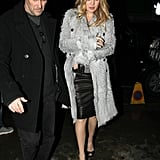 I love the look of Kate Hudson's cozy coat thrown glamorously over a leather pencil.