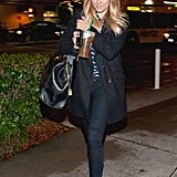 Lauren styling her skinny jeans with ballet flats and a black coat in 2012.