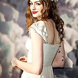 From the floral headpiece to the romantic waves, Anne nailed the princess look for the White Fairy Tale Love Ball in 2011. Bright red lipstick brought it all together.