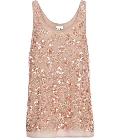Wear this floaty, feminine tank top with a pair of white skinny jeans.  Reiss Kelly Sequined Top ($210)