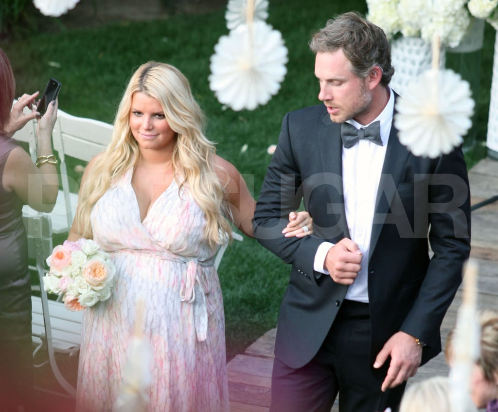 Jessica Simpson walked with fiancé Eric Johnson down the aisle at a friend's wedding.