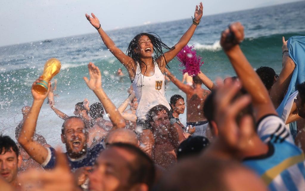 Argentina fans splashed around on Copacabana Beach in Rio de Janeiro after their team beat Switzerland.