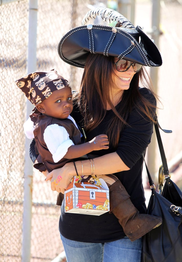 Sandra Bullock and her son Louis were both dressed as pirates for a Halloween party in Brentwood, CA on Sunday. Little Louis was decked out in a head-to-toe getup while Sandra kept things simple with her pirate hat. Sandra has been spending most of her time in LA lately and was recently spotted out dancing late night with Heidi Klum. Sandra scored her Oscar for her work in The Blind Side a couple years ago and her latest film is again starting award season whispers. The Extremely Loud and Incredibly Close trailer was released, and it's already one of the more anticipated films of the holiday season. Sandra also weathers frequent rumors about her personal life, but for now she is focused on her main man Louis.