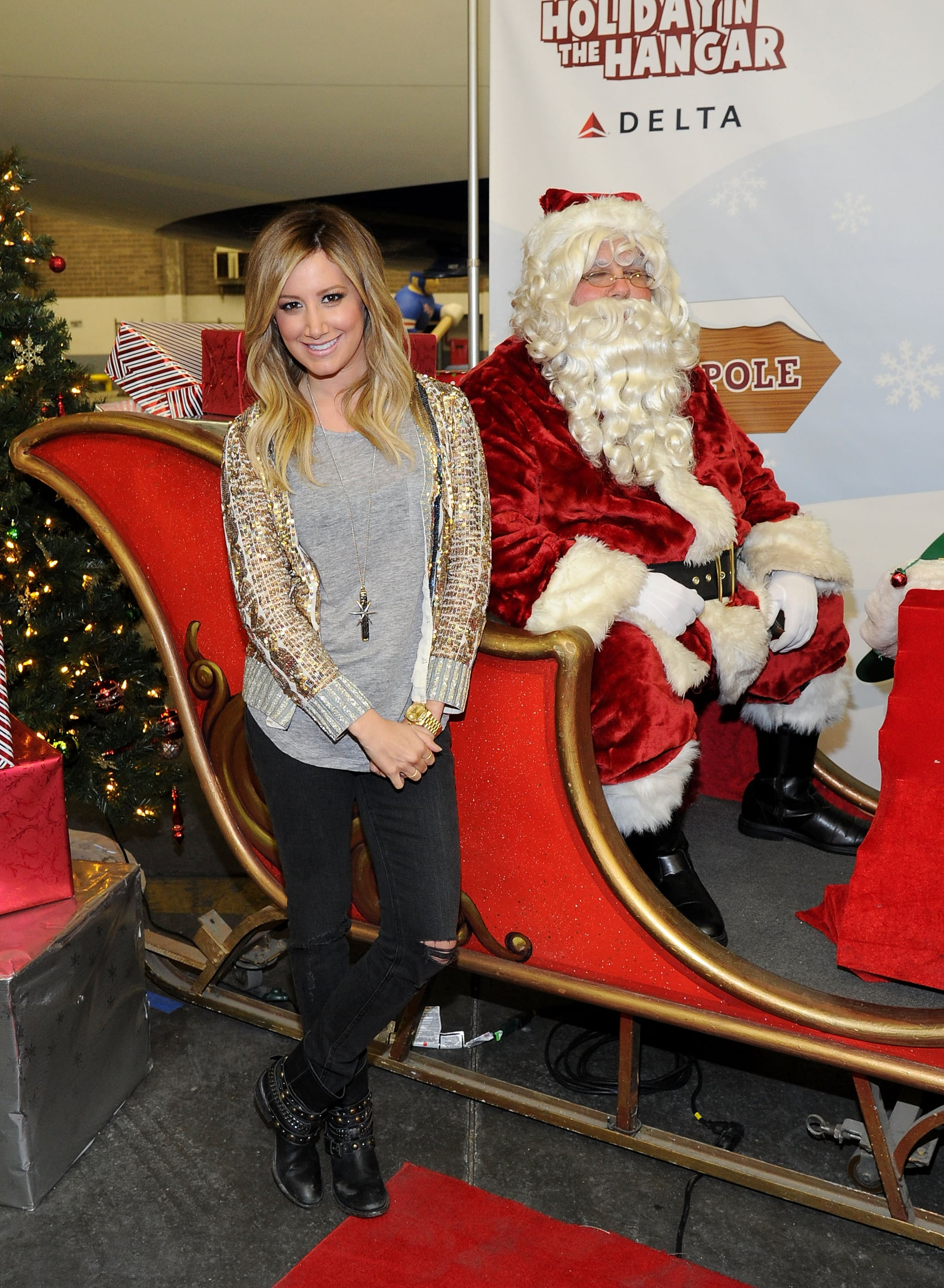 """Ashley Tisdale jingled all the way with Santa Claus at the Delta """"Holiday Flight"""" in NYC."""