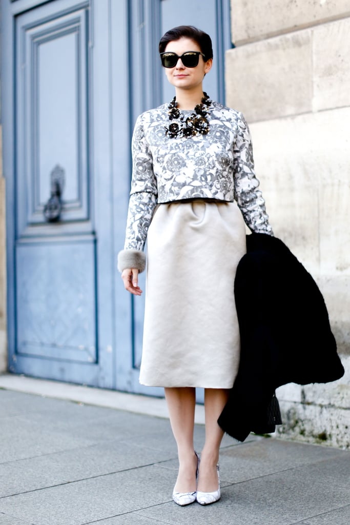 We love that this showgoer echoed the floral print of her blouse with a statement necklace.