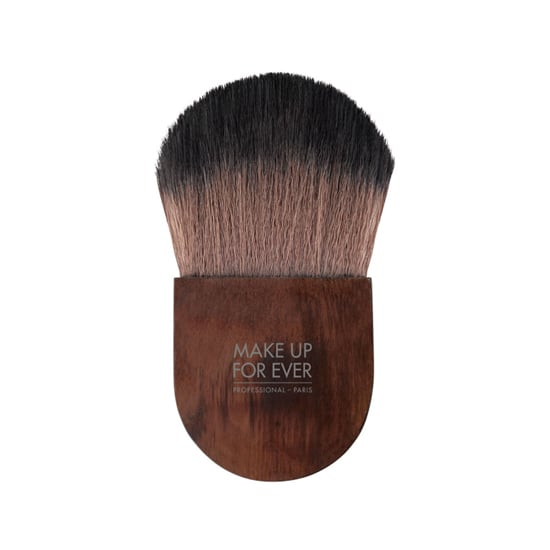 The Make Up For Ever Flat Kabuki Brush ($55) is the newest makeup brush that should be in everyone's makeup bag. It's small enough to tag along with you anywhere you need to take it, plus it can be used for multiple things. You can apply a dusting of translucent powder to your entire face or just contour using the tip and dab on a flush of cheek color, too. And the dark wood finish makes this brush one you'll love to whip out for all those touch-ups.  — JC
