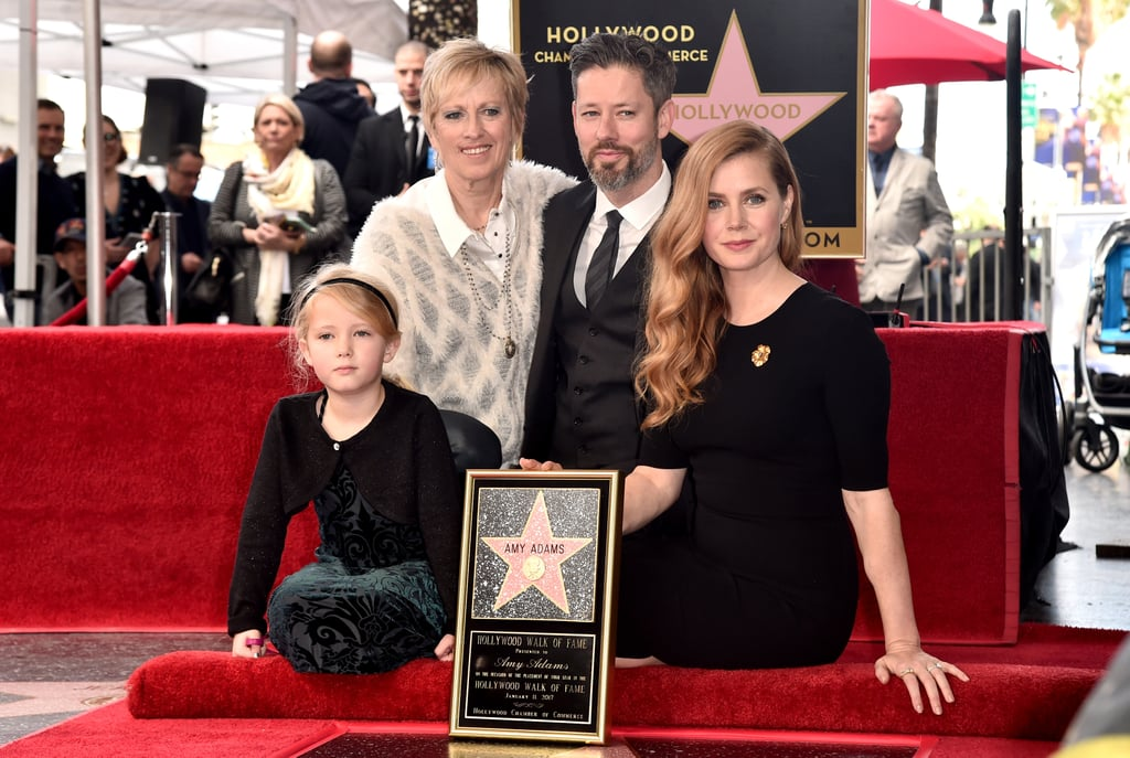 After her stylish night out at Sunday's Golden Globes, Amy Adams had husband Darren Le Gallo, 6-year-old daughter Aviana, and mom Kathryn by her side when she stepped out for her Hollywood Walk of Fame ceremony on Wednesday. The Nocturnal Animals star was honored with the 2,598th star for her work in the entertainment industry, and we just couldn't get enough of her cute interactions with Aviana. While being presented with her star, the mother-daughter duo shared a few laughs and little Aviana even joined her mom in kissing her star. Earlier this month, Amy's Doubt costar, Viola Davis, received a star of her own and was also joined by her gorgeous family. One thing is for sure: if they don't get these pictures framed, we will.       Related:                                                                Amy Adams and Her Husband Steal Some Kisses During a Glamorous Red Carpet Event                                                                   Here's the Mind-Blowing Twist in Arrival, Amy Adams's Alien Saga