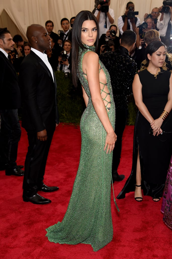 Kendall Jenner wowed in green at Monday night's glamorous Met Gala in NYC. Last year, Kendall made her Met Gala debut in a light pink gown, and this year, she went with a sexy, strappy Calvin Klein dress, showing off her modeling skills as she struck all the right poses on the red carpet. Keep reading for more must-see pictures of Kendall at the Met Gala, then check out all the celebrities on the red carpet, including more of the Kardashian-Jenner clan.