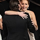 Jennifer Lawrence got a loving hug and kiss on the cheek from her Silver Linings Playbook costar Bradley Cooper at the Oscars in February 2013.